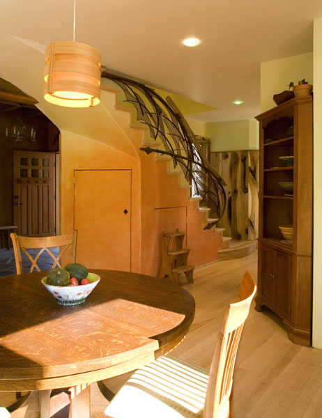 Kitchen as the heart of the home - views towards the main entrance and recycled steel staircase.