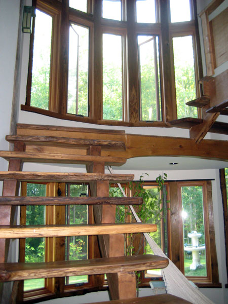 Bow windows and hand made stairs.