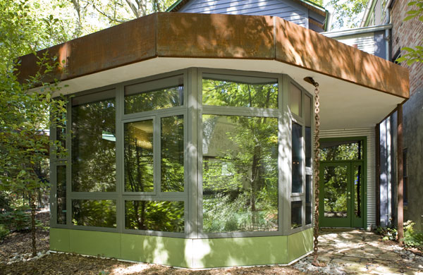 Sunroom addition with window walls.