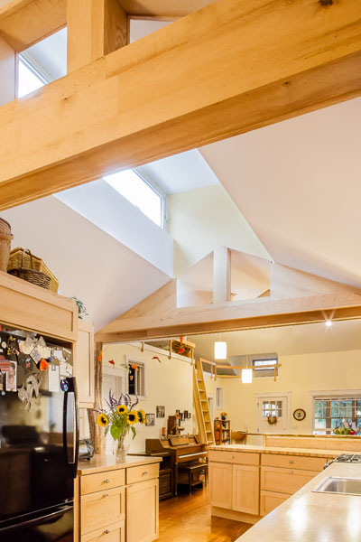 Central light lantern over the kitchen and transom beams.