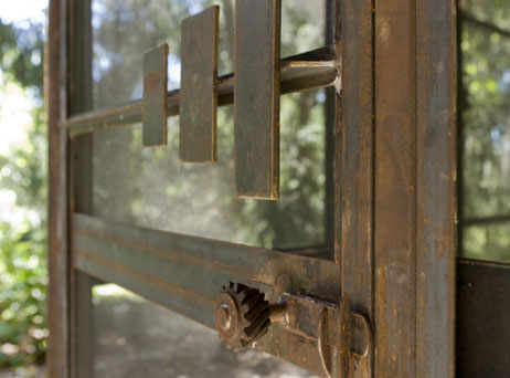 Handcrafted metal door for screened porch.