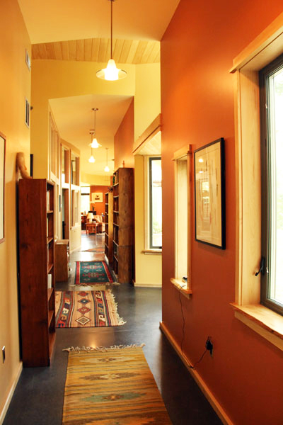 Long hallway with plenty of natural light opens up to all rooms in the house.