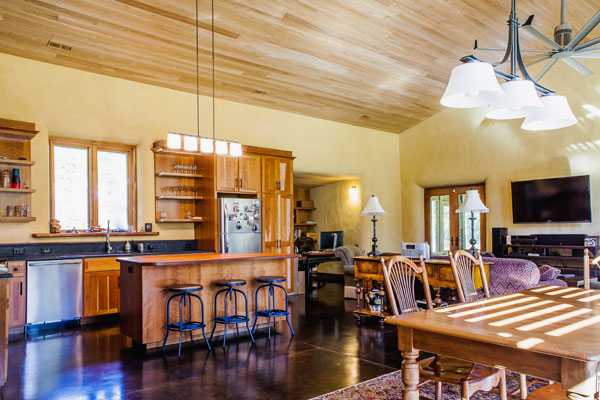 Great room with open plan kitchen and dining.