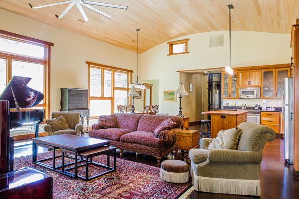 Great room with arched ceiling and passive ventilation.
