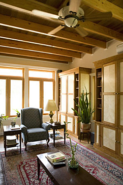 Large living room windows and repurposed wood cabinetry.
