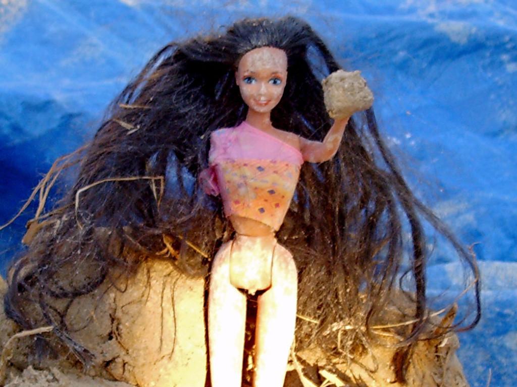 Barbie doll in mud