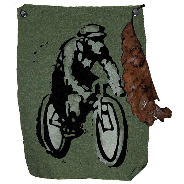 Image of man on bike and dry leaf